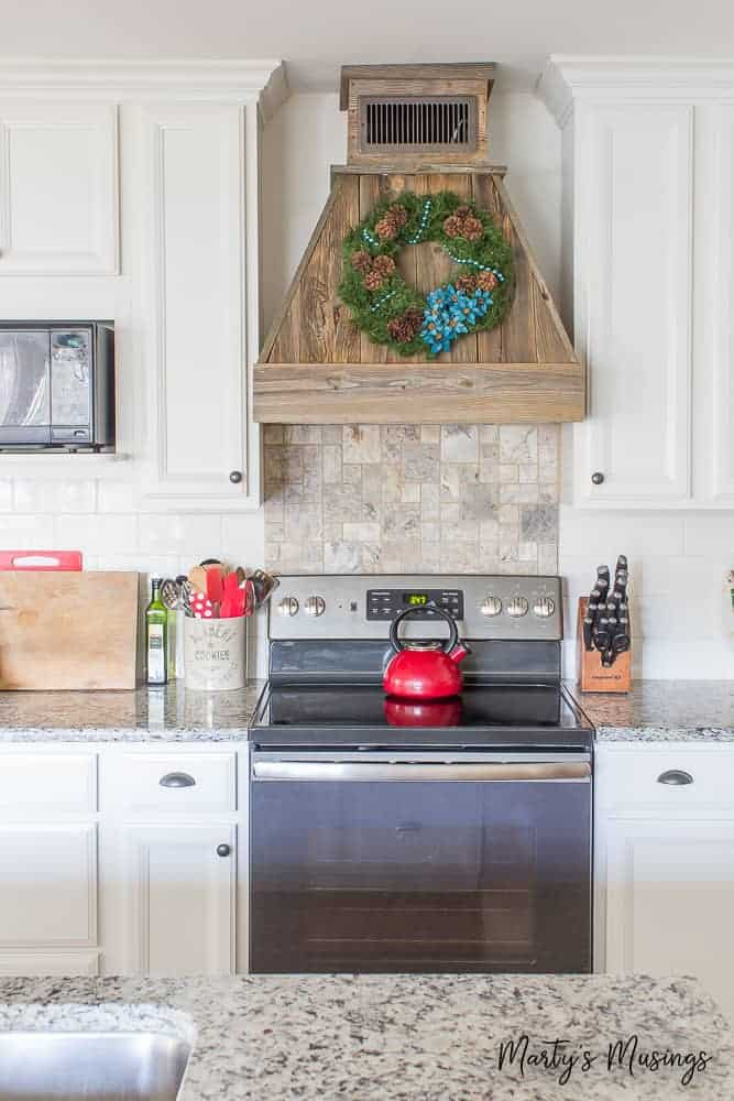 this rustic christmas kitchen decor is simple to pull together using aqua and red accents for - Christmas Kitchen Decor