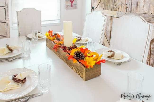 white farmhouse kitchen table with rustic fall centerpiece