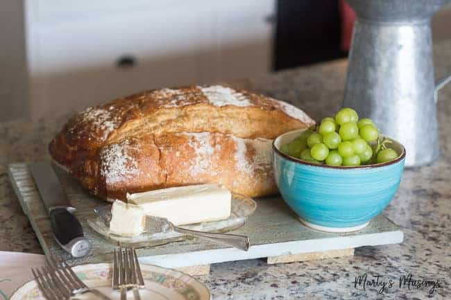 Homemade bread and grapes and on granite countertop
