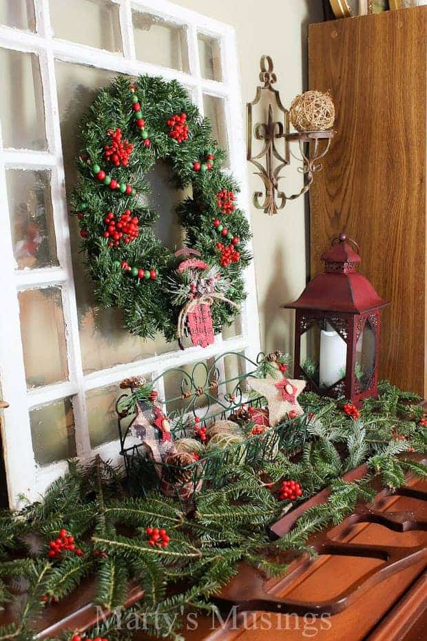 How to decorate a pretend mantel with evergreens and repurposed items.