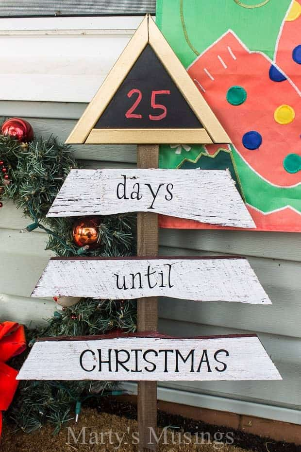 Wooden Christmas tree countdown spray painted with chalkboard paint numbers.