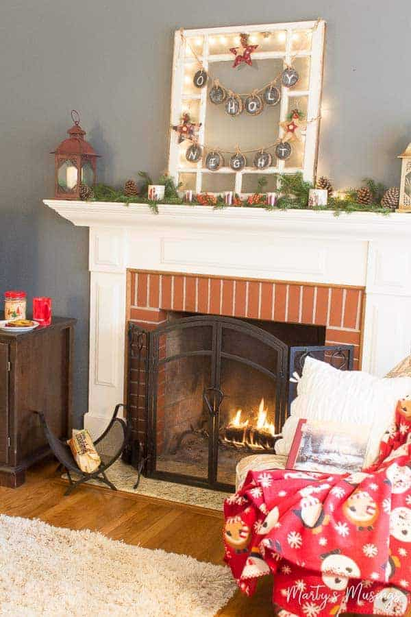 Tips for decorating a Christmas mantel the cheap way with nature and repurposed accessories.