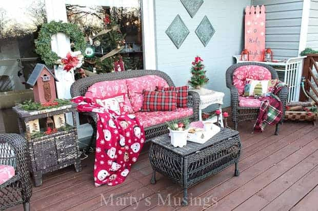 Inexpensive ideas for decorating your deck for Christmas including repurposed treasures and yard sale items.