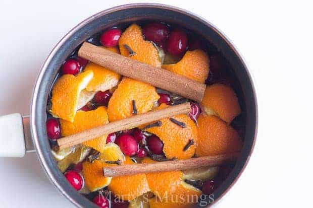 simmering homemade potpourri made with oranges, cranberries, cinnamon sticks and cloves
