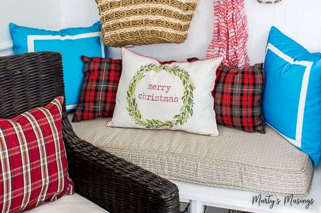 Merry Christmas pillow with red plaid and aqua accent pillows