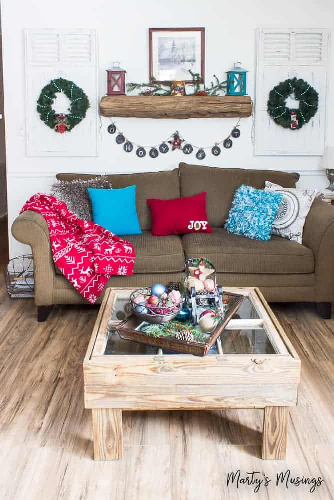 rustic Christmas home with red and aqua accents in the living room