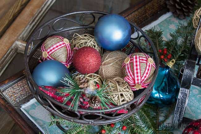 rustic ornaments in metal basket with greenery