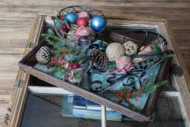 rustic ornaments on wooden tray with natural elements