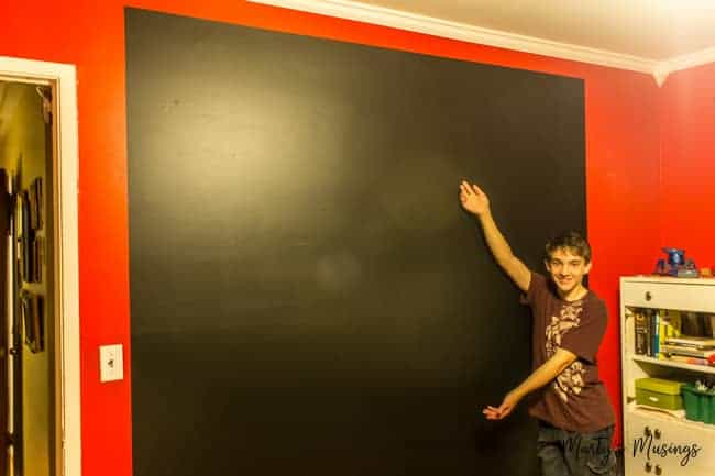 large chalkboard wall on top of red painted room