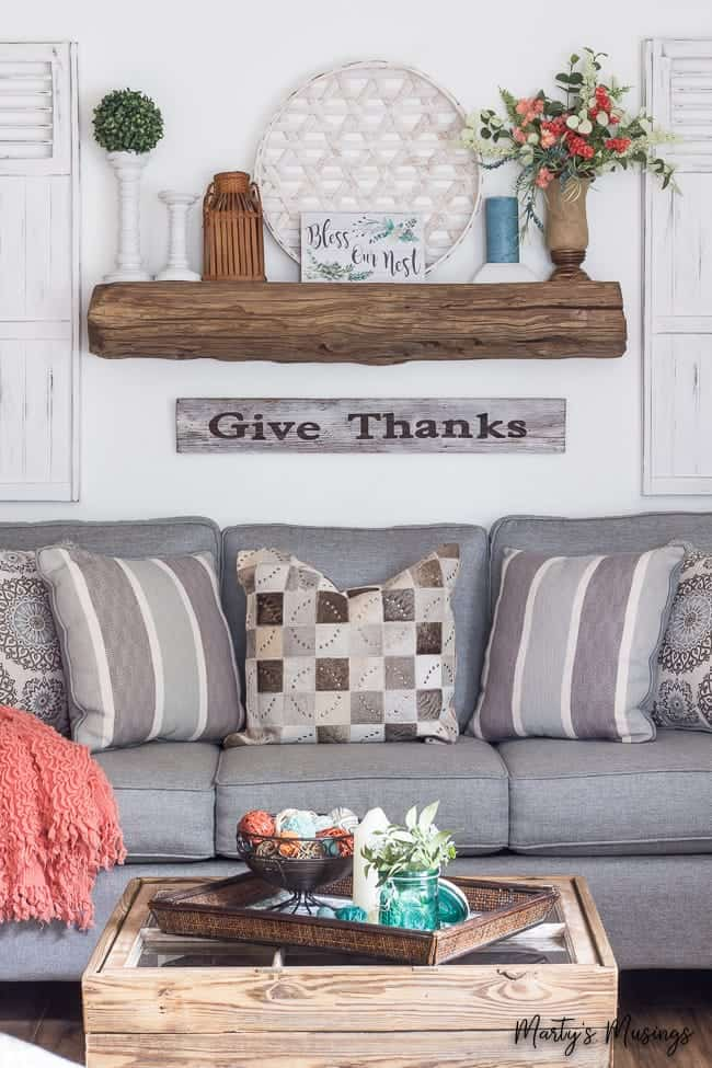 blue sofa with barn wood mantel and table