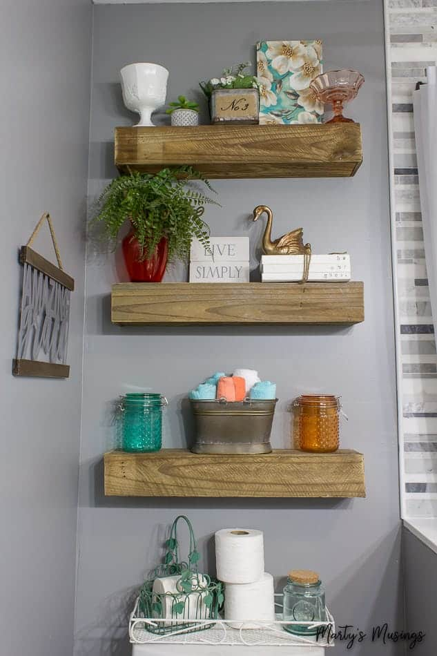farmhouse floating shelves with inexpensive decor in bathroom