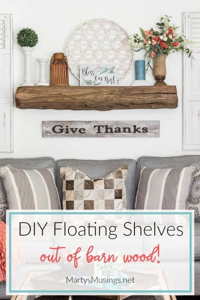 Floating shelves made out of barn wood for a mantel above sofa