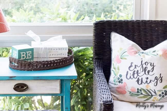 stamped farmhouse books on side table with enjoy the little things pillow