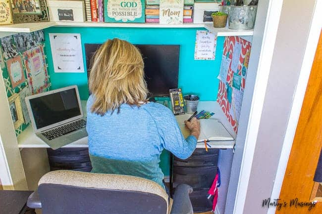 Journaling at home office desk in a closet nook
