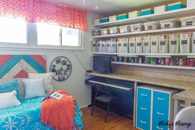 craft room with long shelves and day bed in coral and aqua
