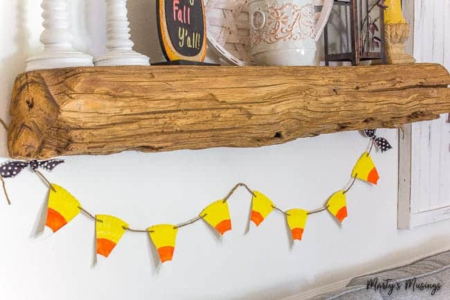 barn wood mantel with candy corn banner