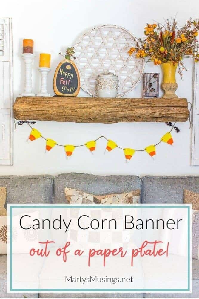 candy corn banner hung from barn wood mantel