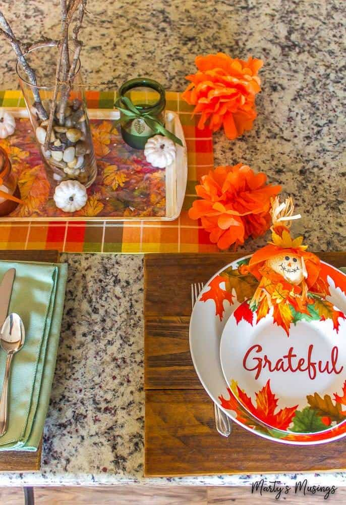 orange tissue pom poms on fall table