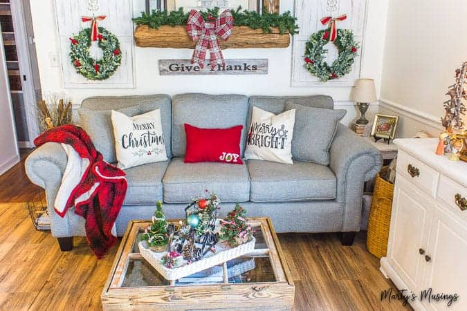 Red and green Christmas decorations in rustic living area