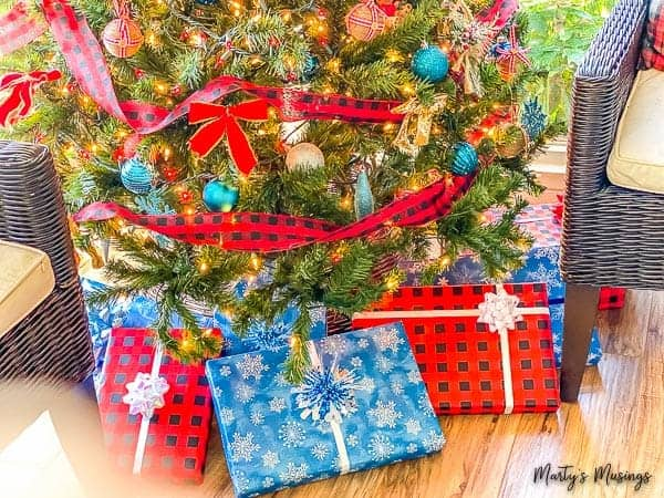 Red and blue Christmas presents under the tree