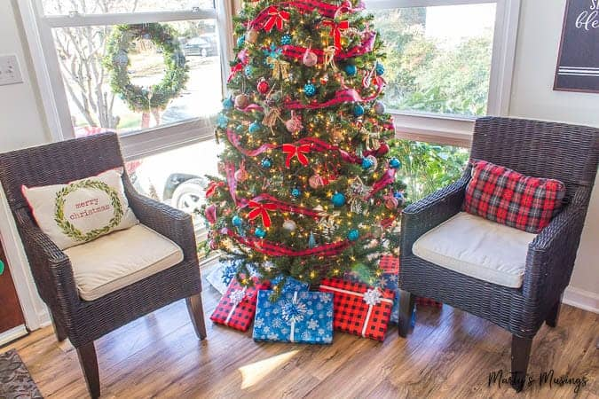 blue and red Christmas tree with buffalo plaid presents