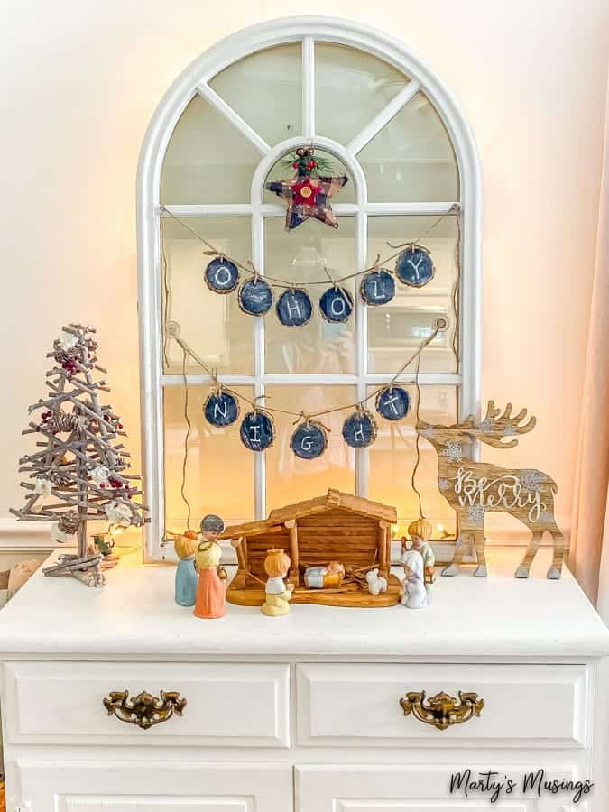 Chalk painted buffet with cathedral window and nativity scene