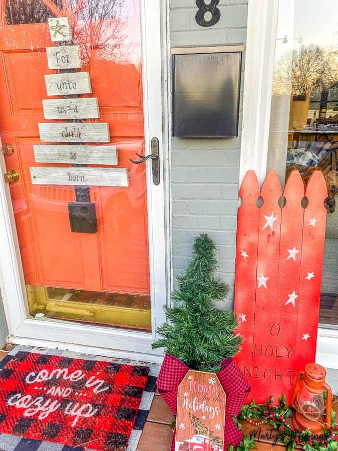 front porch decorated with repurposed Christmas tree