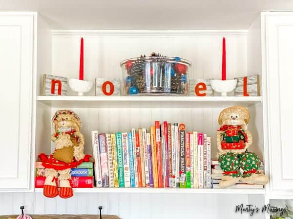 drop zone shelves decorated with noel sign and ornaments