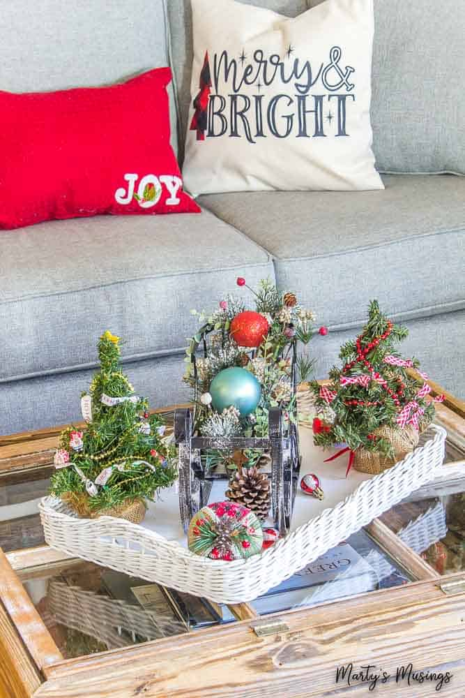 white tray with metal sleigh and Christmas pillows