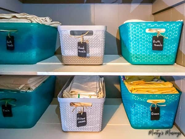 Blue and gray baskets for linen closet storage