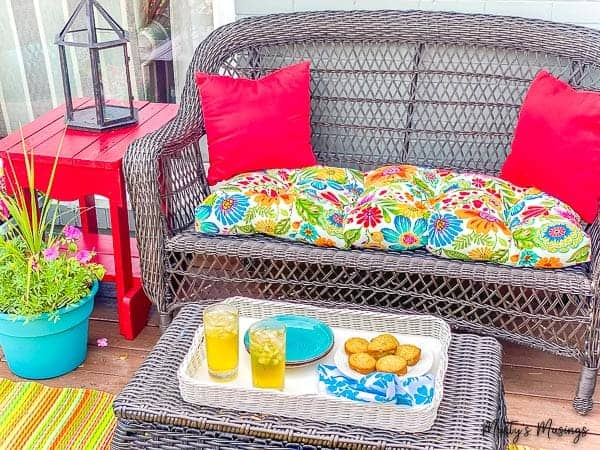 deck furniture with red table and blue flower planter