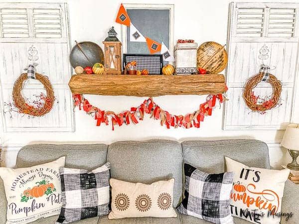 Fall mantel with thrift store accessories and fabric banner