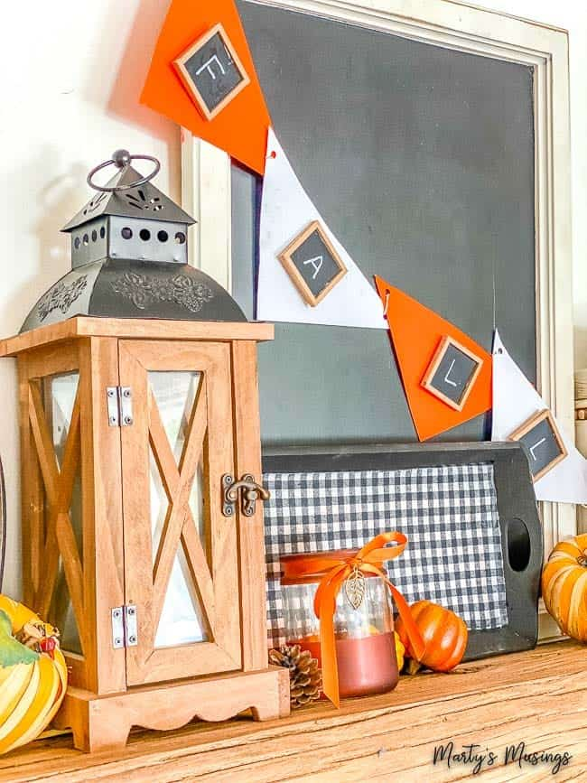 Mantel with fall banner and buffalo check tray