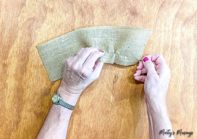 Pull thread through burlap ribbon