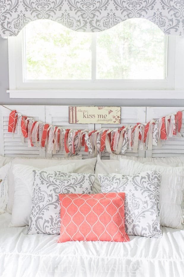 Rag banner hanging from bedroom headboard