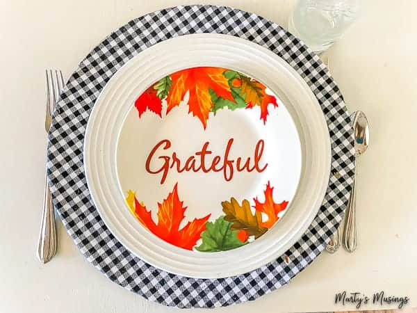 Black and white buffalo plaid charger with grateful plate