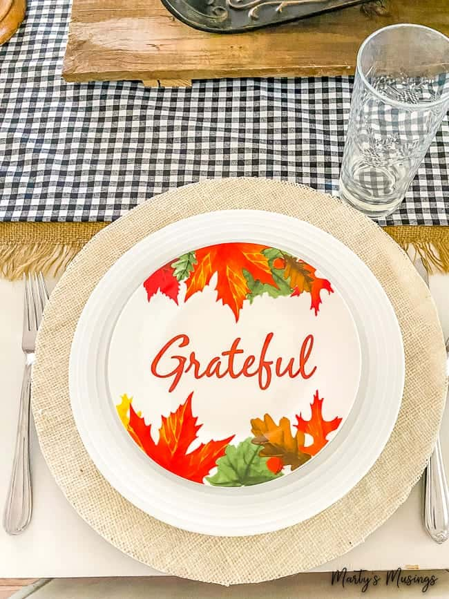 burlap charger with grateful plate and plaid table runner