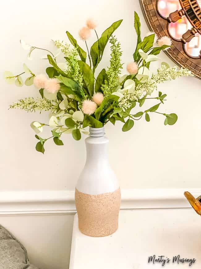 DIY textured vase out of a milk bottle with greneery