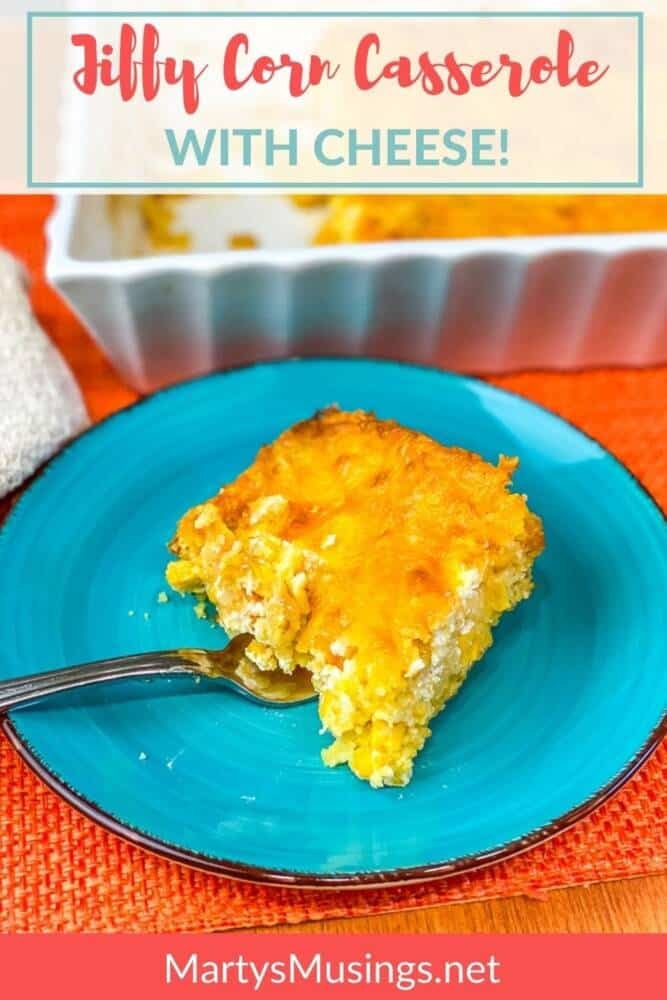 jiffy corn casserole with cheese on blue plate in front of white dish