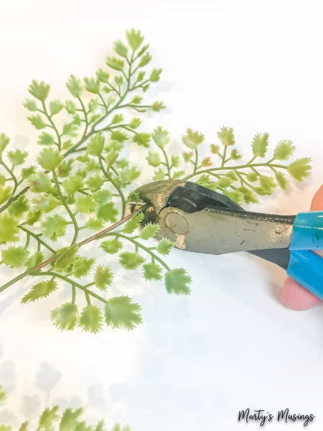 cut artificial greenery with pliers