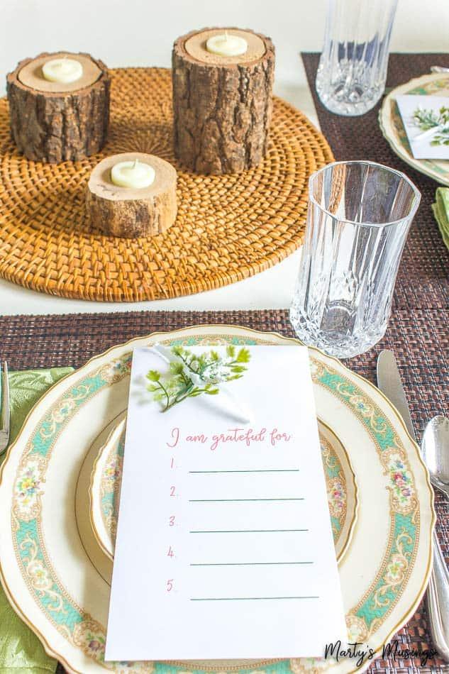 gratitude printable with wood log candles and vintage china