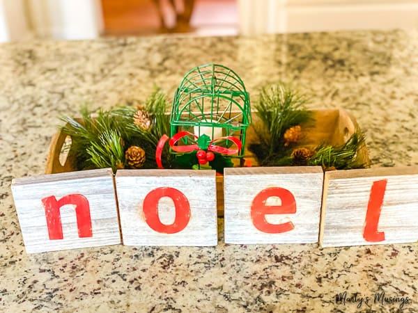 wooden noel blocks on kitchen countertop