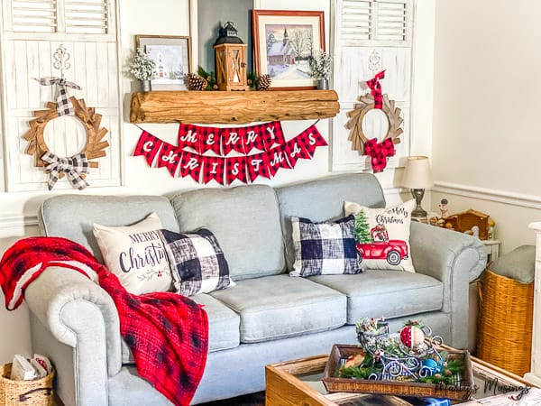 corner of Christmas room decorated with red and black buffalo plaid and rustic wood accents