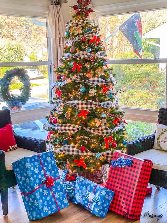 Christmas tree with blue and red buffalo plaid accents with ornaments and presents