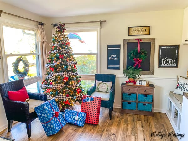 living room decorated for Christmas with blue and red accents and Christmas tree