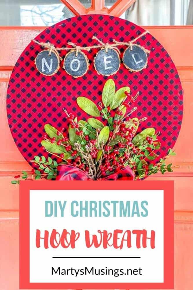 DIY Christmas hoop wreath hanging on coral front door