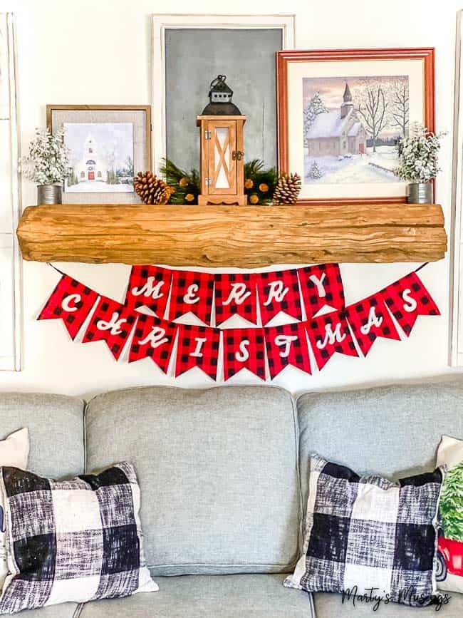 Buffalo plaid Merry Christmas banner with rustic mantel and decor