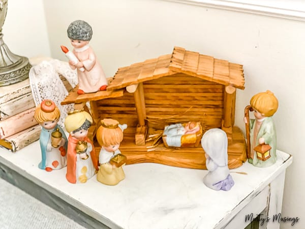 Precious Moments ceramic nativity center on a side table