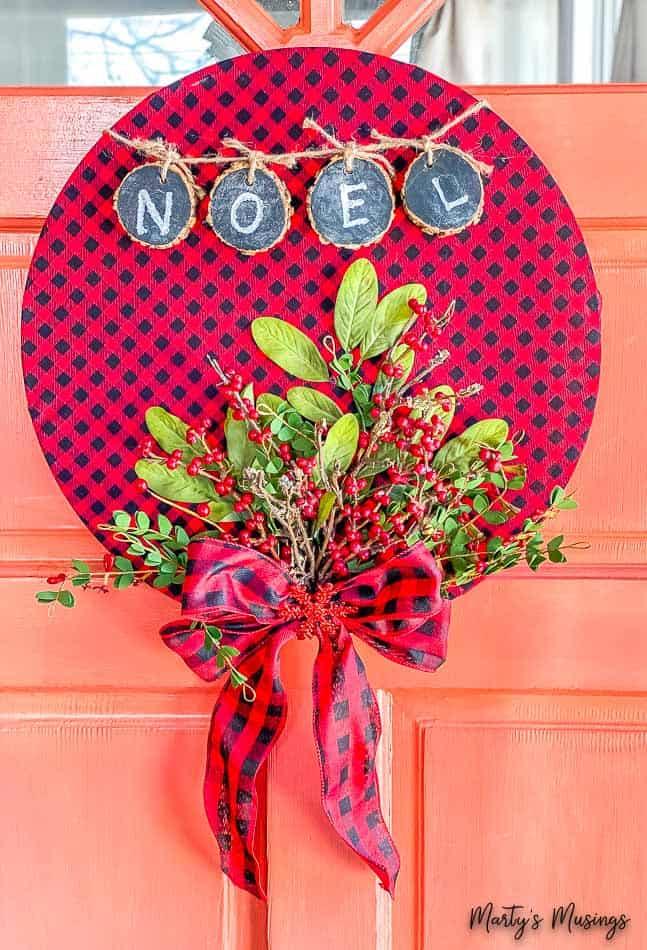 buffalo plaid hoop wreath with Christmas flowers