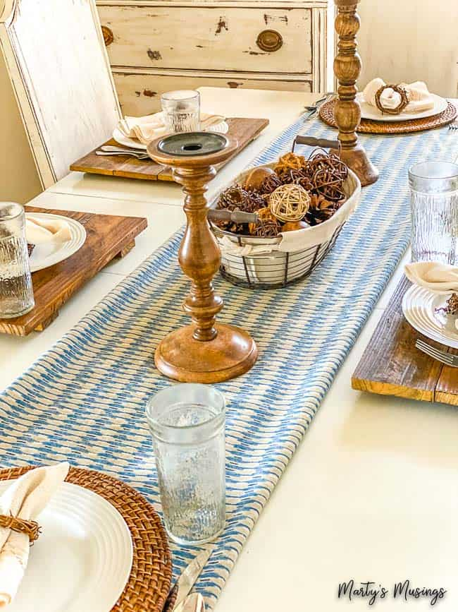 vintage sheet folded over as table runner with wood accents